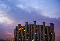 Multistoreyed building in Gurgaon with cloudy colorful sky. Multistoreyed apartments in Gurgaon India against a colorful cloudy sky. The lights of the individual Stock Photos