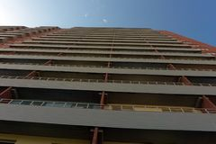 Multistory apartment house with long balconies. stock photography
