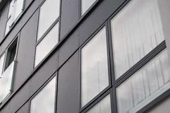 Multistory building. Photo of a modern multistory building facade Royalty Free Stock Photo
