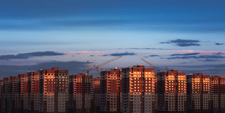 Multistory houses. New district apartment houses in Russia at sunset Royalty Free Stock Photos