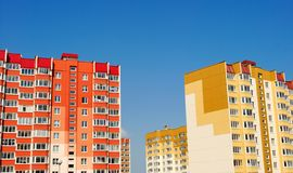 Multistory yellow and red houses Stock Photos
