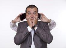 Multitarefa com telefones celulares Fotografia de Stock Royalty Free