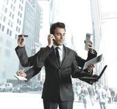 Multitarefa do homem de negócios Fotos de Stock