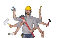 Multitasking arbeider met overvloed van hulpmiddelen stock foto's