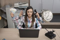 Multitasking business woman is a real miracle at work. Office situation stock images