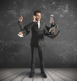 Multitasking businessman. Businessman stressed by too many tasks Royalty Free Stock Image
