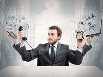 Multitasking businessman Stock Image