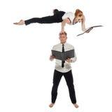 Multitasking. Businessmen-acrobats work in pair Royalty Free Stock Image