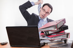 Multitasking employee stressed playing hangman Royalty Free Stock Images