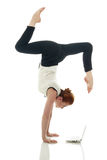 Multitasking. Girl doing handstand with laptop Royalty Free Stock Images