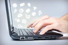 Multitasking on Laptop With Media Icons Royalty Free Stock Photo