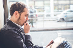 Multitasking man using tablet, laptop and cellhpone Stock Images