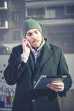 Multitasking man using tablet, laptop and cellhpone Royalty Free Stock Image