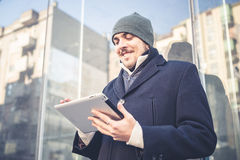 Multitasking man using tablet, laptop and cellhpone Royalty Free Stock Photography