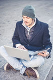Multitasking man using tablet, laptop and cellhpone Royalty Free Stock Images