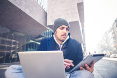 Multitasking man using tablet, laptop and cellhpone Royalty Free Stock Photos