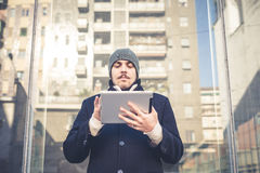 Multitasking man using tablet, laptop and cellhpone Stock Photo