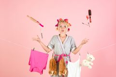 Multitasking mom. Performing Different Household Duties. Busy mother. Vintage housekeeper woman. Working from home. Maid. Or housewife cares about house. happy royalty free stock images