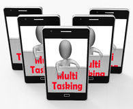 Multitasking Phone Means Doing  Multiple Tasks Simultaneously. Multitasking Phone Meaning Doing  Multiple Tasks Simultaneously Stock Image