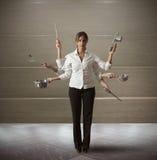 Multitasking woman in kitchen Royalty Free Stock Images