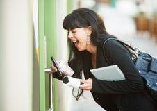 Multitasking Woman Opening Door Stock Photo