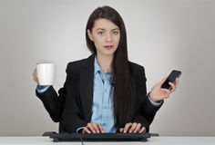 Multitasking woman Royalty Free Stock Photo