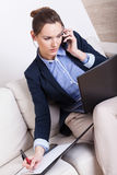 Multitasking woman working at home Royalty Free Stock Photo