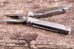 Multitool, multi purpose tool with plyers Royalty Free Stock Photos