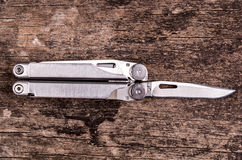 Multitool, multi purpose tool with plyers and Stock Photo