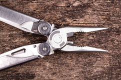 Multitool, multi purpose tool with plyers and Royalty Free Stock Photos