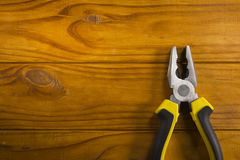 Multitool pliers on wooden background Royalty Free Stock Images
