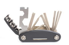 Multitool unfolded. Isolated on white background Royalty Free Stock Images