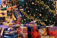 Christmas gifts round the base of a Christmas tree royalty free stock image