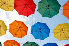 Colorful umbrellas in the sky Stock Images