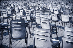 Multitude of empty chair on road pavement Stock Photo