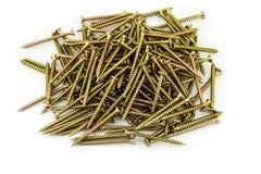 A multitude Galvanized golden screws on white background Stock Photo