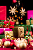 Multitude of Plain Xmas Presents. Many unicolored Christmas gifts piled up either side of the tight frame. Shallow depth of field with focus on the golden bow Royalty Free Stock Photography
