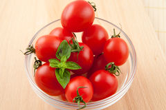 Multitude of tomatoes in glassware Royalty Free Stock Images