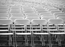 A Multitude of White Plastic Chairs Royalty Free Stock Images