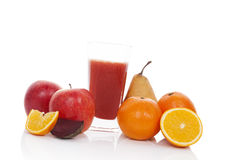 Multivitamin juice. Fresh fruit and juice in glass on white background. Ripe pear, apple and orange juice Royalty Free Stock Photos