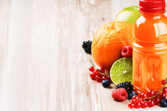 Multivitamin juice and fresh fruits Royalty Free Stock Images
