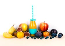 Multivitamin juice with organic autumn seasonal fruits. Diet and healthy food concept Stock Photo