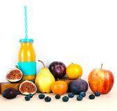 Multivitamin juice with organic autumn seasonal fruits. Diet and healthy food concept Royalty Free Stock Photography