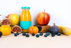 Multivitamin juice with organic fruits. Multivitamin juice with organic autumn seasonal fruits. Diet and healthy food concept Royalty Free Stock Image