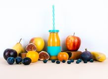 Multivitamin juice with organic seasonal fruits. Multivitamin juice with organic autumn seasonal fruits. Diet and healthy food concept Stock Photo
