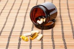 Multivitamin Pills in a brown medicine jar Royalty Free Stock Photos