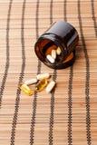 Multivitamin Pills in a brown medicine jar Stock Images