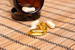 Multivitamin Pills in a brown medicine jar Royalty Free Stock Photo