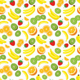 Multivitamin seamless background with whole pineapple, fresh green kiwi slices, strawberries, oranges and bananas. Royalty Free Stock Images