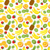 Multivitamin seamless background with whole pineapple, fresh green kiwi slices, strawberries, oranges and bananas. Royalty Free Stock Photo